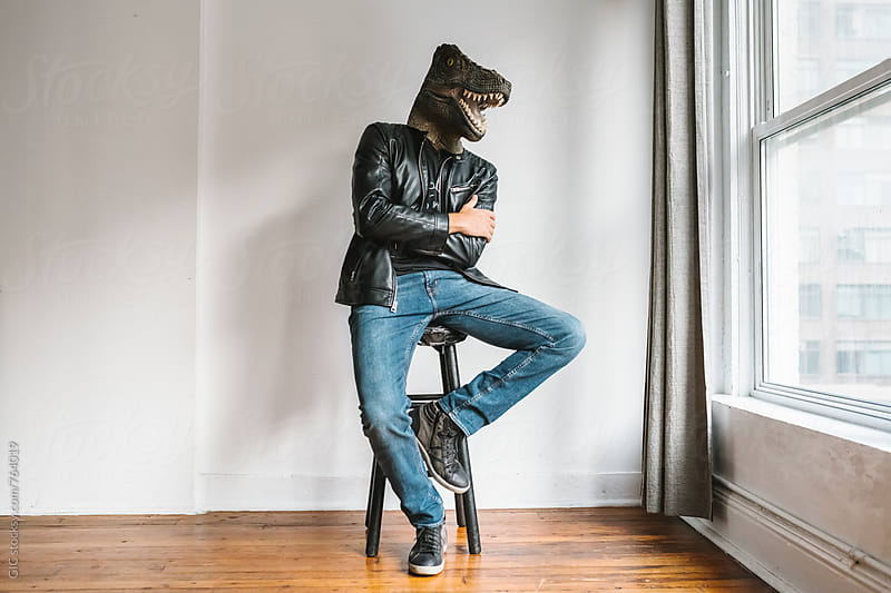 Man with a T-Rex mask by Simone Becchetti for Stocksy United