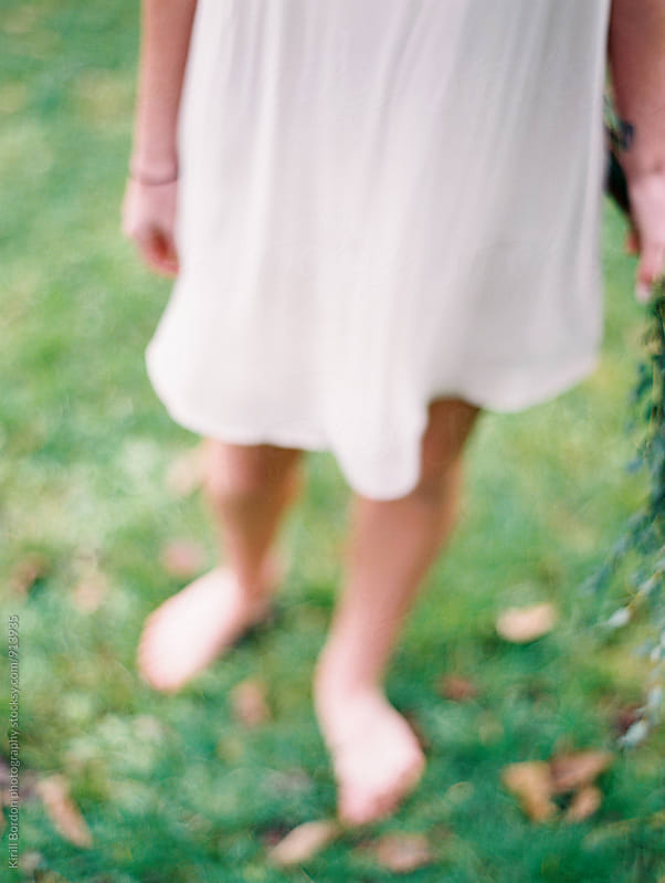 barefeet on grass by Kirill Bordon photography for Stocksy United