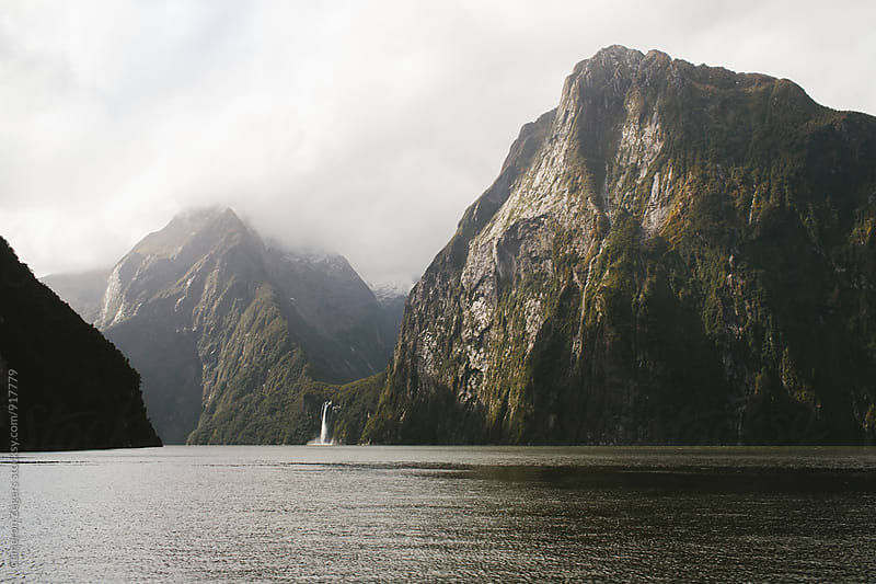 waterfall in Milford Sound, New Zealand. by Cameron Zegers for Stocksy United