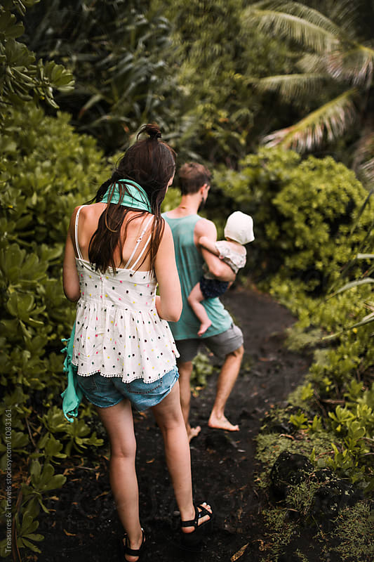 Family walking through the Jungle by Treasures & Travels for Stocksy United