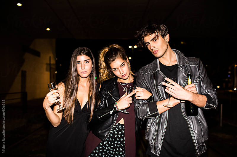 Portrait of a group of friends at night in city by michela ravasio for Stocksy United