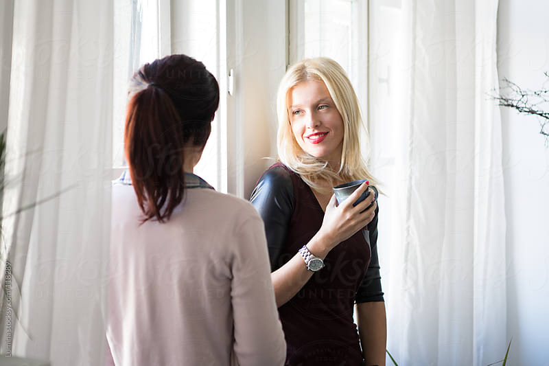 Women Chatting by the Window by Lumina for Stocksy United