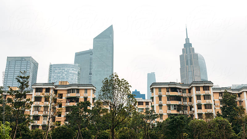 City skyline of commercial and residential buildings in China by Lawrence del Mundo for Stocksy United