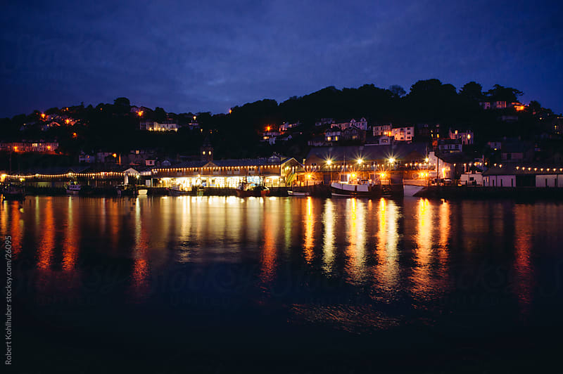 Fishing village with small harbour in Cornwall, UK by Robert Kohlhuber for Stocksy United