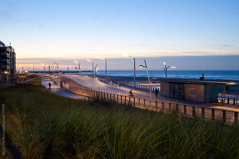 People enjoying the sunset on Scheveningen Boulevard by Denni Van Huis for Stocksy United