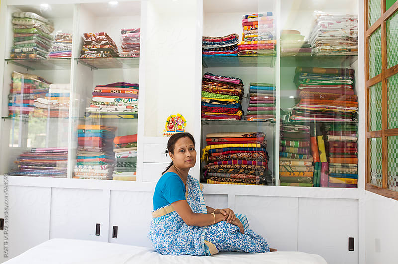 An Indian woman who run the small business of Indian Traditional dress by PARTHA PAL for Stocksy United
