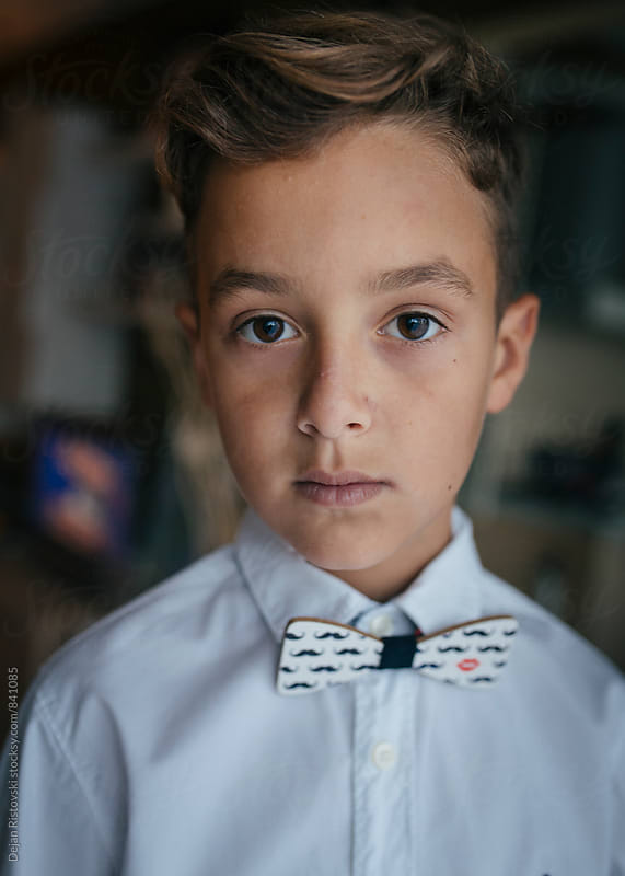 Boy with bowtie. by Dejan Ristovski for Stocksy United