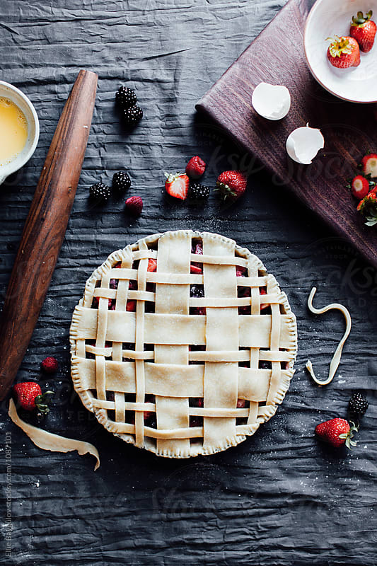 Berry pie prep by Ellie Baygulov for Stocksy United