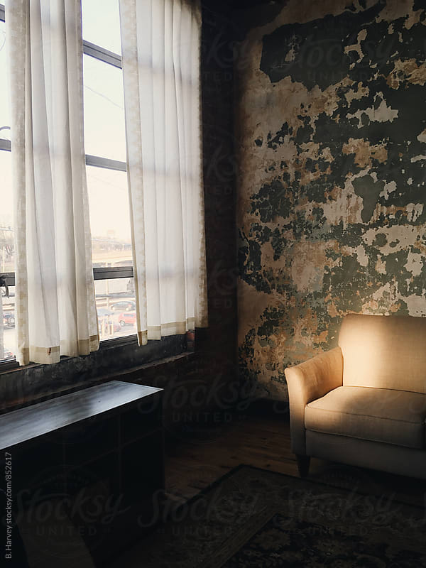 Beautiful Light on a Classic Couch in a Rustic Room by B. Harvey for Stocksy United