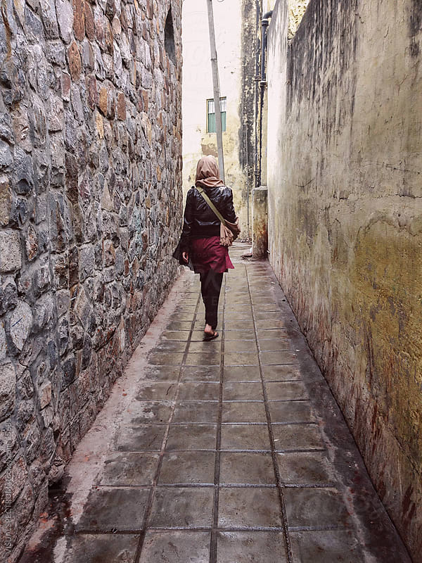 Woman Walking in Alley by VISUALSPECTRUM for Stocksy United