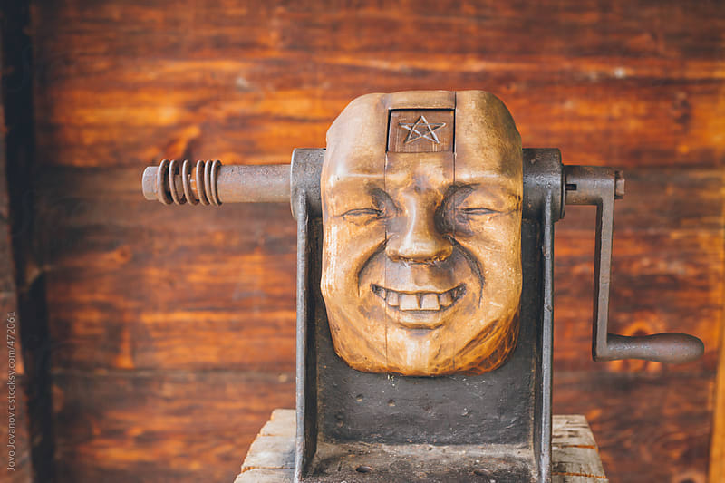 Old art piece machine with a face on it by Jovo Jovanovic for Stocksy United