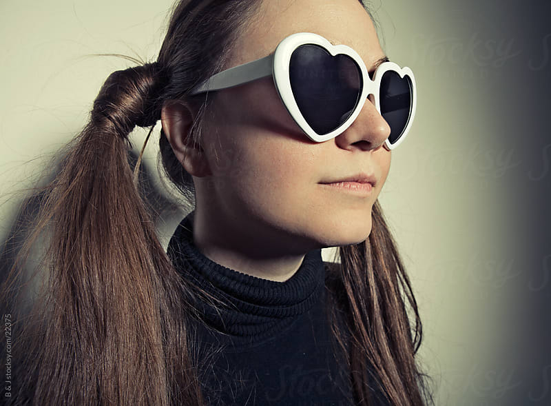 Funny Portrait Of A Girl Wearing Heart Shaped Glasses by B & J for Stocksy United