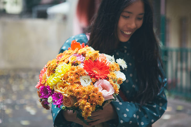 Asian Woman With Flowers Outdoors by Lumina for Stocksy United