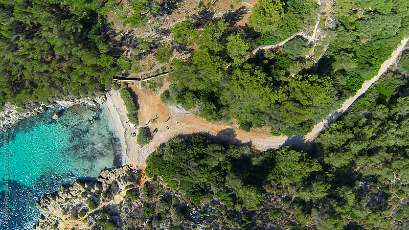 Aerial view of a beautiful small beach by Leandro Crespi for Stocksy United