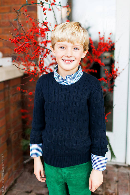 portrait of a boy dressed for a holiday event  by Kelly Knox for Stocksy United