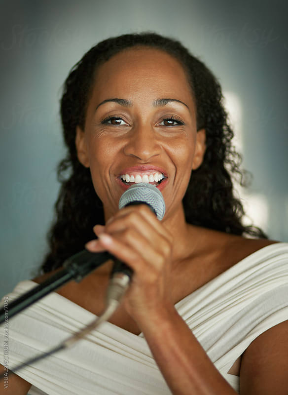 Woman Singing into Microphone by VISUALSPECTRUM for Stocksy United