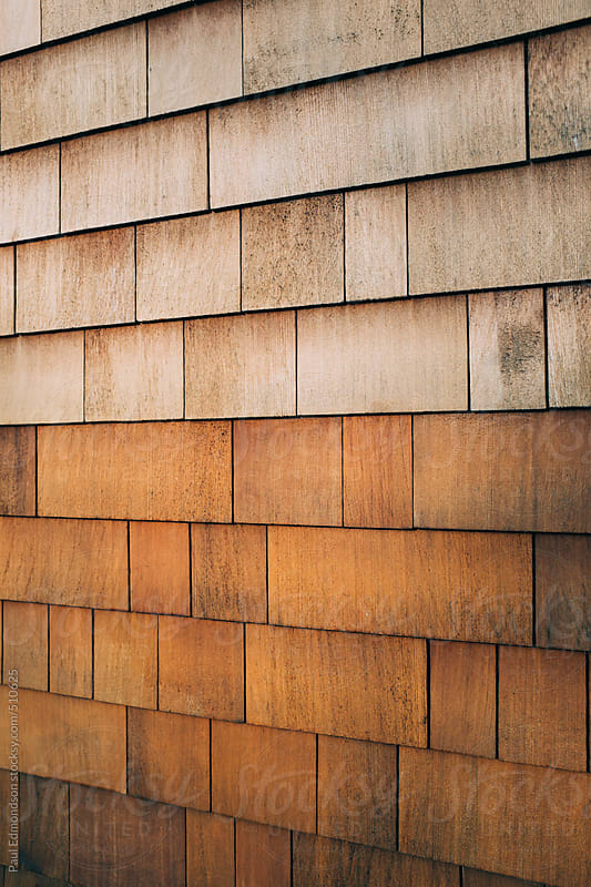 Cedar shingles on building wall exterior by Paul Edmondson for Stocksy United