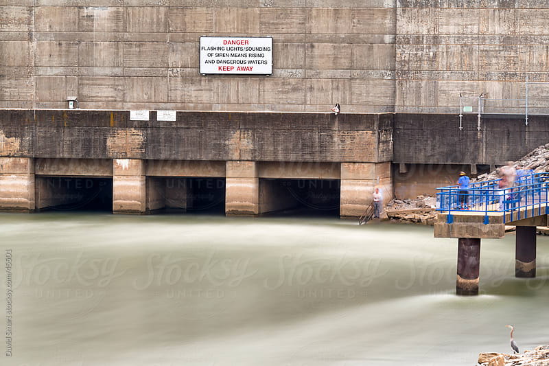 Anglers fishing in tailrace of Chickamauga Dam on Tennessee River by David Smart for Stocksy United