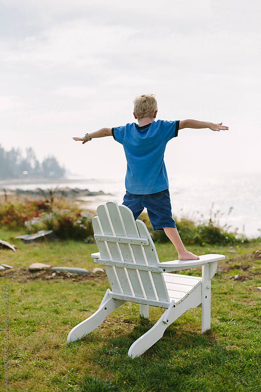 Child Playing by Seacoast  Maine, USA by Raymond Forbes LLC for Stocksy United