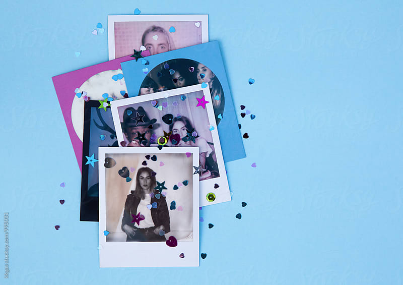 Polaroid print of best friends on a blue background with glitter by kkgas for Stocksy United