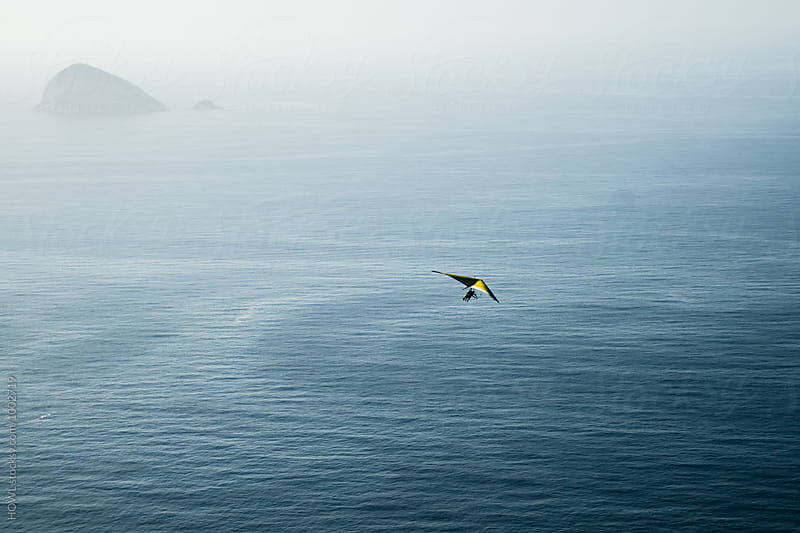 Brave hang glider soars through the skies over rio de aneiro by HOWL for Stocksy United