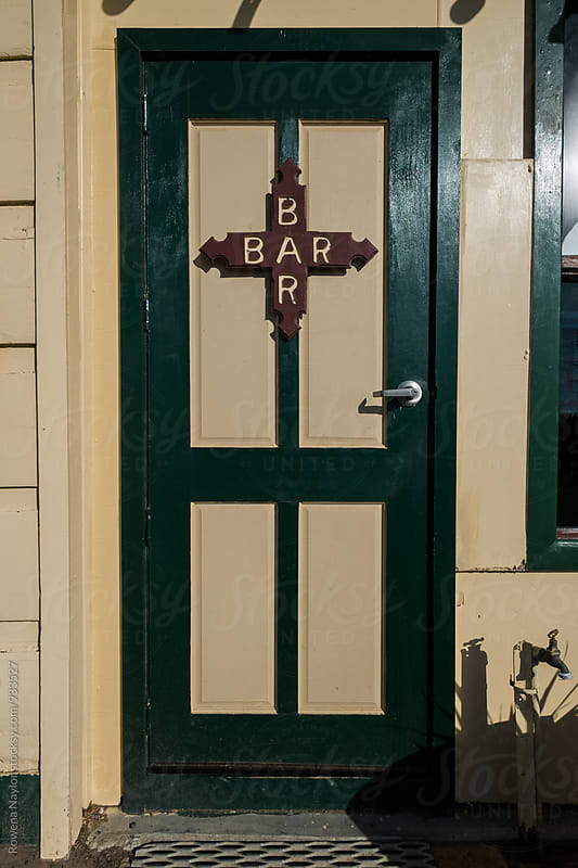 Door with Bar written on it horizontally and vertically by Rowena Naylor for Stocksy United