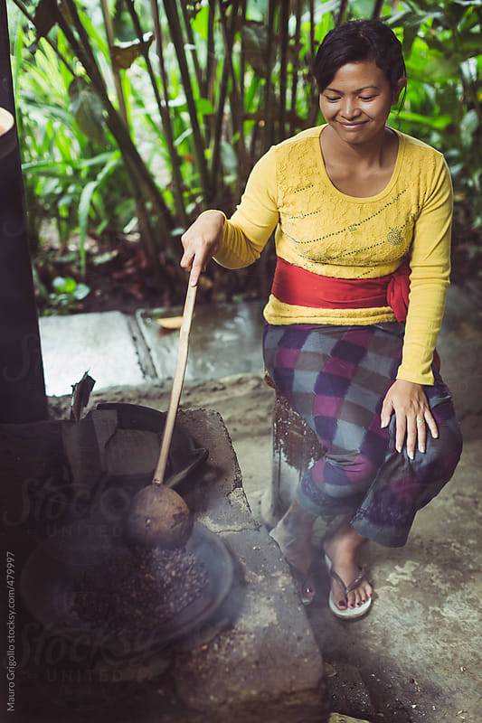 Woman working on roasting coffee beans by Mauro Grigollo for Stocksy United