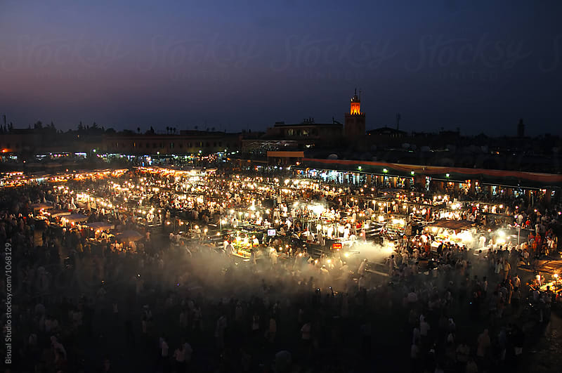 Food market in Djemaa el-Fna at sunset, Marrakech, Morocco by Bisual Studio for Stocksy United