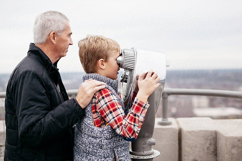 grandfather and grandchild sightseeing in a city by Kelly Knox for Stocksy United