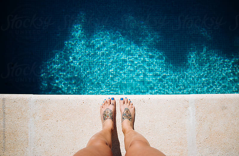 Feet to the edge of a pool by Susana Ramírez for Stocksy United