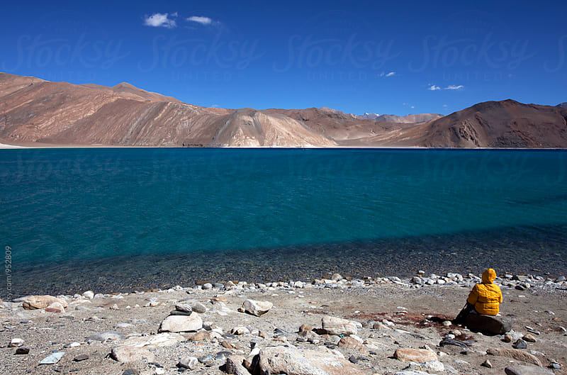 A woman enjoy the beauty of Pangong Lake,Ladakh,India by PARTHA PAL for Stocksy United