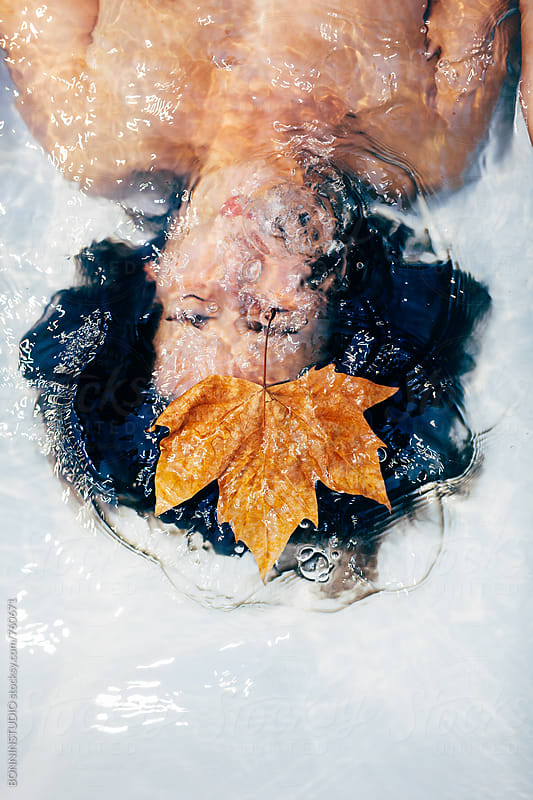 Woman holding breath underwater in the bathtub. by BONNINSTUDIO for Stocksy United