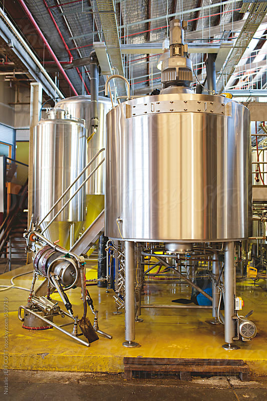 brewery vats and kegs brewing beer at micro brewery by Natalie JEFFCOTT for Stocksy United
