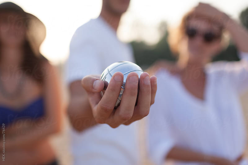 Man Holding a Bocce Ball During the Game . Close up by HEX. for Stocksy United