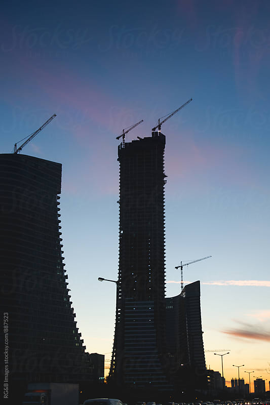 Skyscrapers silhouettes on sky at dawn by RG&B Images for Stocksy United