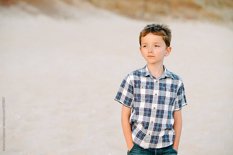Portrait of a handsome boy on the beach by Rebecca Spencer for Stocksy United