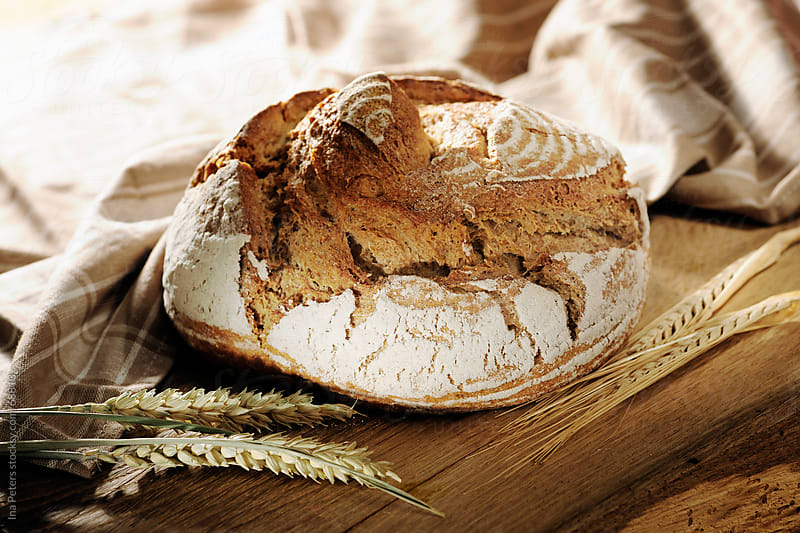 Food: A loaf of freshly baked rye bread by Ina Peters for Stocksy United