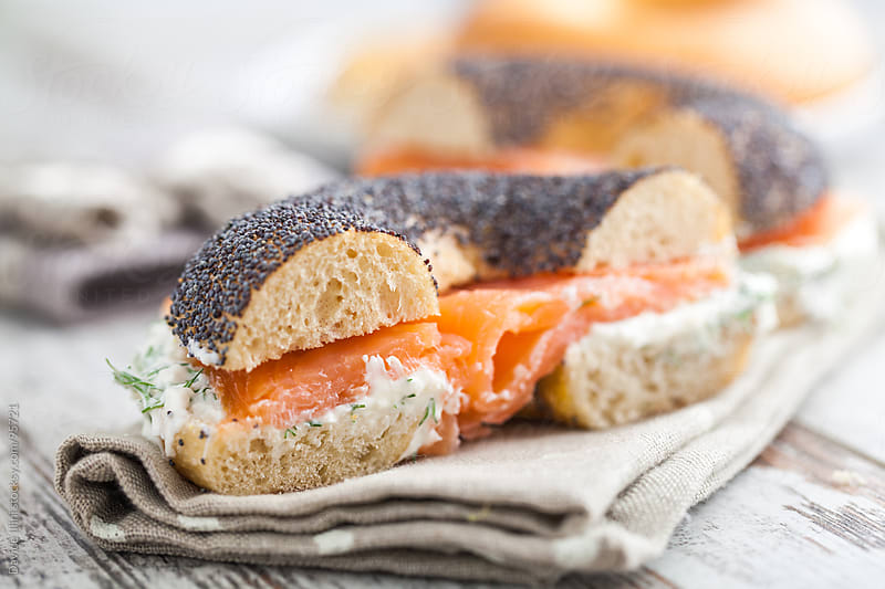Smoked Salmon with cream cheese on a bagel by Davide Illini for Stocksy United