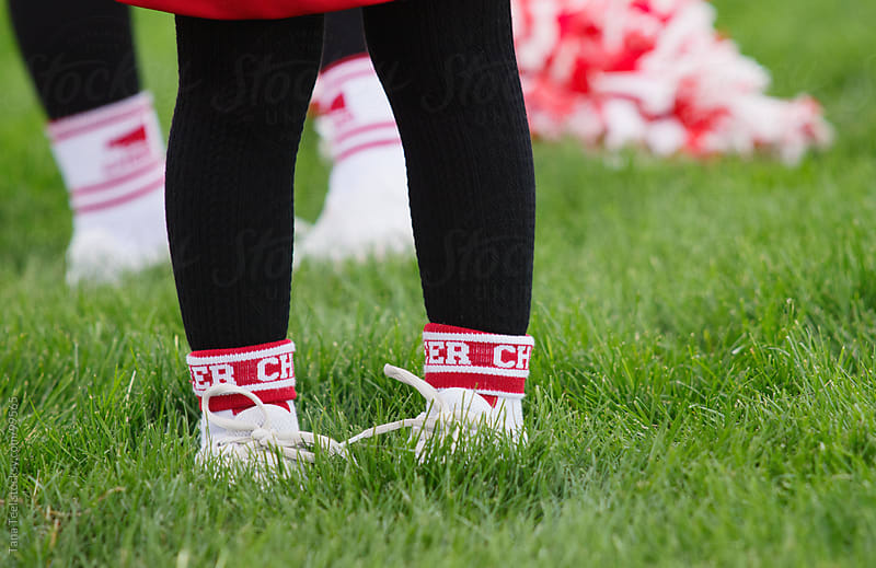 A young cheerleader's cheer socks by Tana Teel for Stocksy United