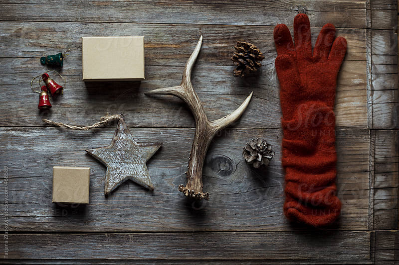 Deer antlers, Christmas ornaments, gifts and glove by Tatjana Zlatkovic for Stocksy United
