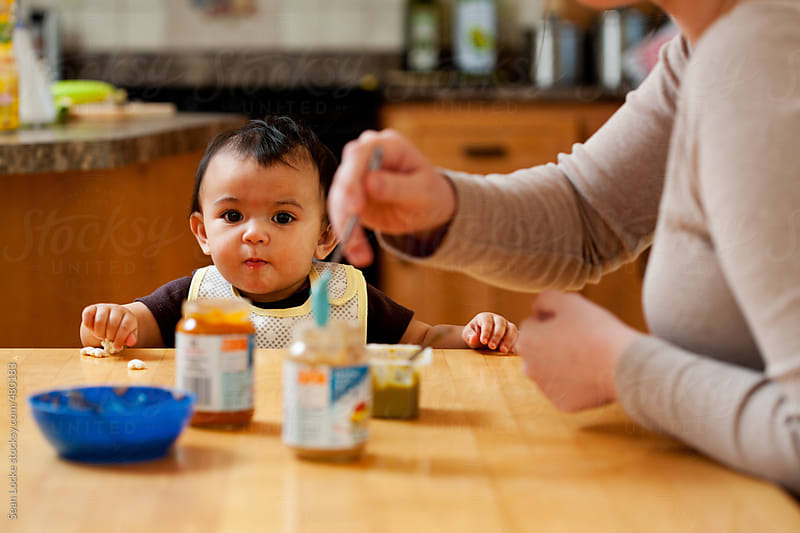 Baby: Mother Trying Variety Of Baby Food by Sean Locke for Stocksy United