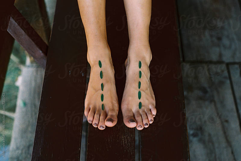 Feet and leaves by Aleksandra Martinovic for Stocksy United