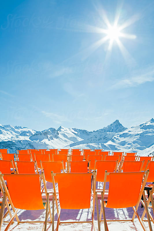 Brightly coloured sun loungers on the slopes of Courchevel 1850 ski resort in the Three Valleys, Les Trois Vallees, Savoie, French Alps, France by Gavin Hellier for Stocksy United