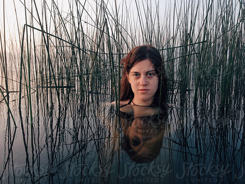 Girl in reeds by Bor Cvetko for Stocksy United