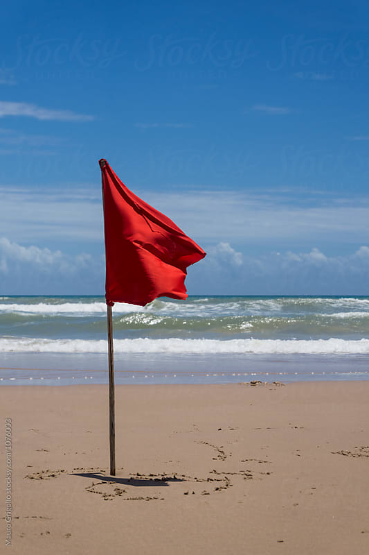 Red Flag on the beach. NO Swim sign by Mauro Grigollo for Stocksy United