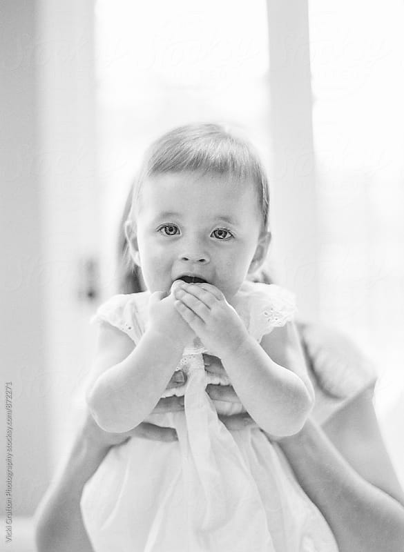 baby girl with mom by Vicki Grafton Photography for Stocksy United