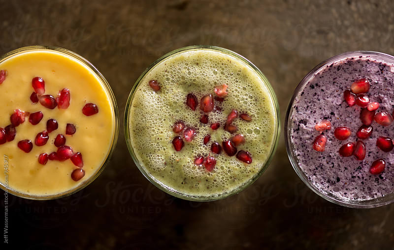 Fruit Smoothie with Pomegranate Seeds by Jeff Wasserman for Stocksy United