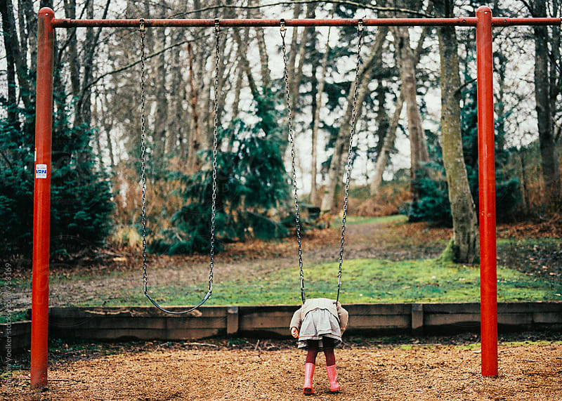 Young Girl Hangs Motionless on a Swing by Amanda Voelker for Stocksy United