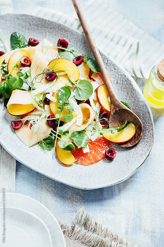 Fruit salad with fennel and watercress by Ellie Baygulov for Stocksy United