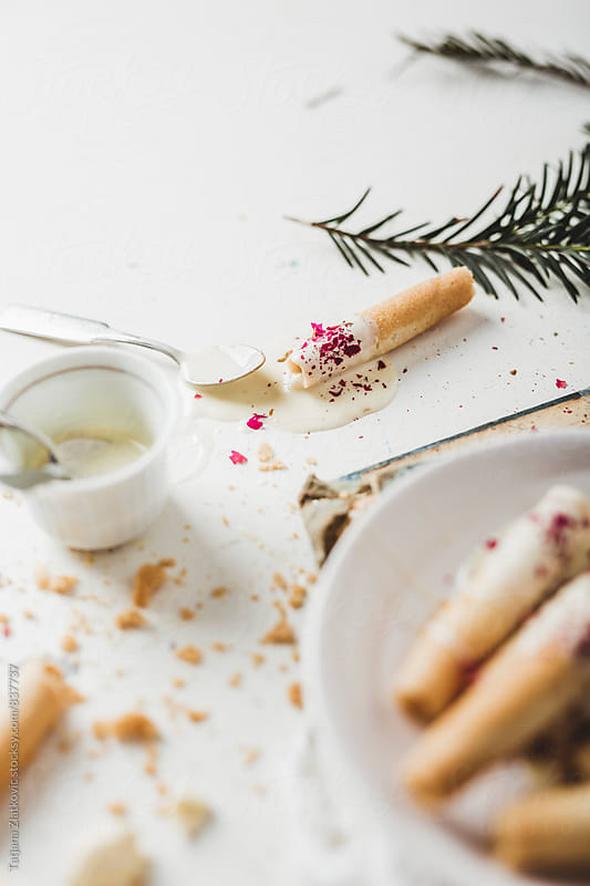 Cigarette cookies with white chocolate by Tatjana Zlatkovic for Stocksy United